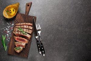 Grilled beef steak on cutting board