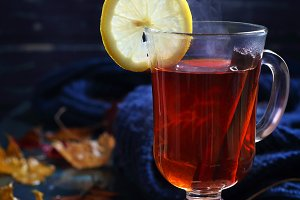 cup of hot black tea with cinnamon