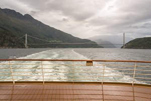 Cruise ship sails under Hardanger bridge in Norway