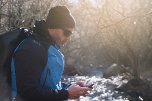 man with smartphone in nature