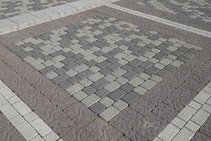 Figure out the paving slabs in the square. Background of paving slabs. Texture of stone products