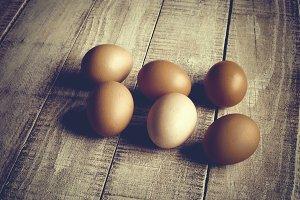 Fresh eggs on rustic wood