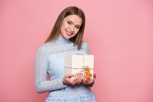Beautiful woman holding present box