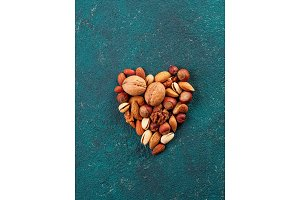 Heart shape made of multiple different nuts and seeds mix