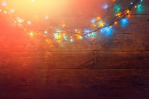 Colorful Electric Garland On A Woode