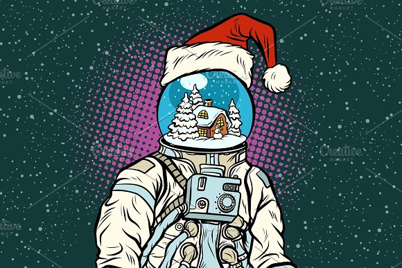 Christmas astronaut with dreams of gingerbread house