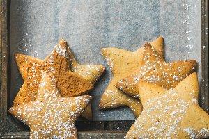 Sweet Christmas gingerbread cookies in shape of stars, copy space