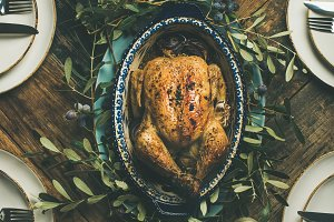 Flat-lay of whole roasted chicken for Christmas over table background