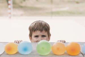 boy looking water balloons
