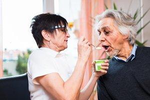 Nurse Feeding Senior Man