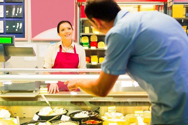 Sales Clerk Talking To Customer