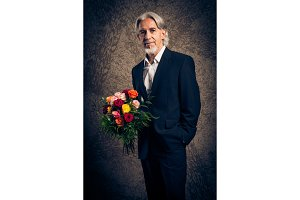 Senior Man With Bouquet Of Roses, Studio Portrait