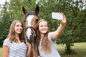 Teenage Girls With Their Pony