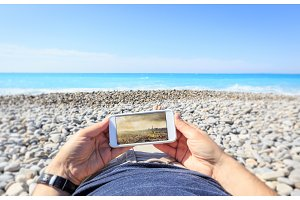 Tourist At The Beach Dreaming Of City Trip To Paris
