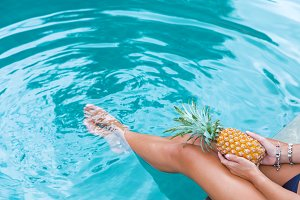 woman pine apple swimming pool