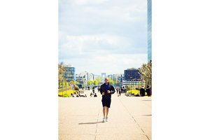 African Man Jogging In La Defense, Paris