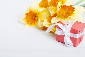 Bouquet daffodils and gift on the wh