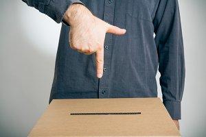 Man Pointing At Ballot Box