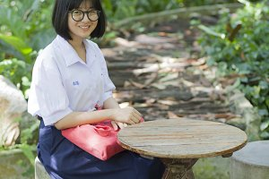 student sitting on the bench.