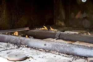 Gas burners at a station for the heating of reservoir fluid. The liquid from the ground is cold and enters the stove where it is heated. Furnace furnace.