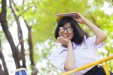 Schoolgirl smiling and happy.