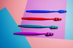 four toothbrushes for oral hygiene. care and health. view from above