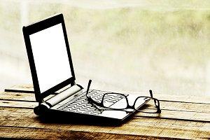 Notebook and eyeglasses
