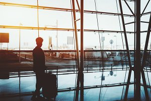 Silhouette: girl near airport window