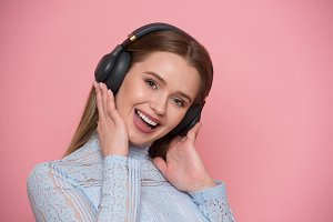 happy young woman listen music