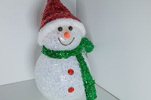 Toy snowman with multi-colored illumination. Christmas and New Year Decoration