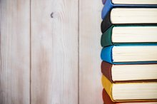 Books standing on the table by Roman Farberov in Education