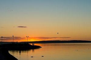 Sunset on the waterfront of Lake Onega. Petrozavodsk. Karelia