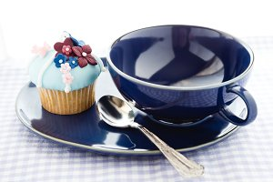 Cupcake and blue cup