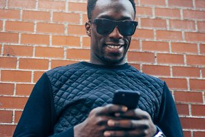Handsome black man with mobile phone.