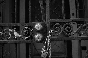 Black and White Locked Gate with Bar