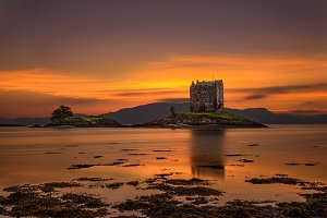 Sunset over Castle Stalker,  Scotland, United Kingdom