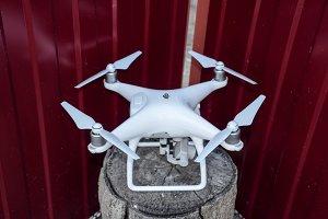 Quadrocopters DJI Phantom 4 on a wooden stump