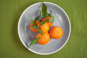 Tangerines on green fabric