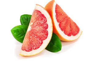 Grapefruit slices with leaves isolated on white background