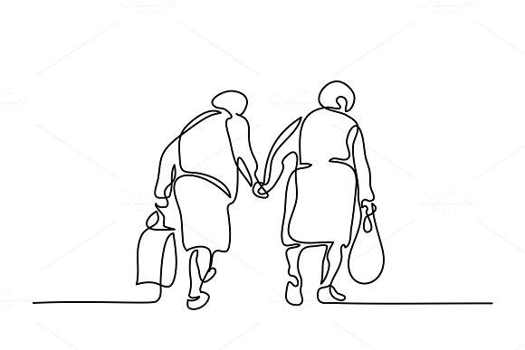 Elderly women friends walking