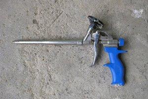 Gun foam. Pistol for adhesive foam