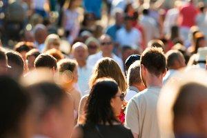 Crowd of people walking on street