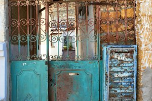 Old rusty iron gate to the yard