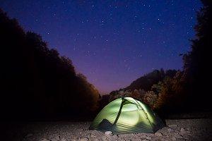 Illuminated green tent at night