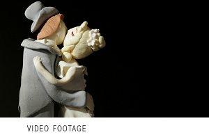 Wedding cake figurines kiss.