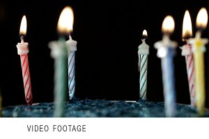 Candles rotation on black background