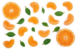 lobules of mandarin or tangerine with leaves isolated on white background. Flat lay, top view. Fruit composition