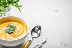 Pumpkin soup with parsley background