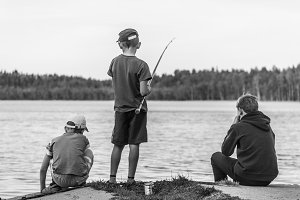 Boys catching fish on the lake