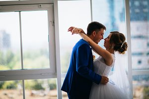 bride and groom on background clear windows